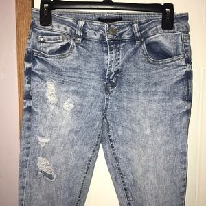 Acid wash distressed skinny jeans